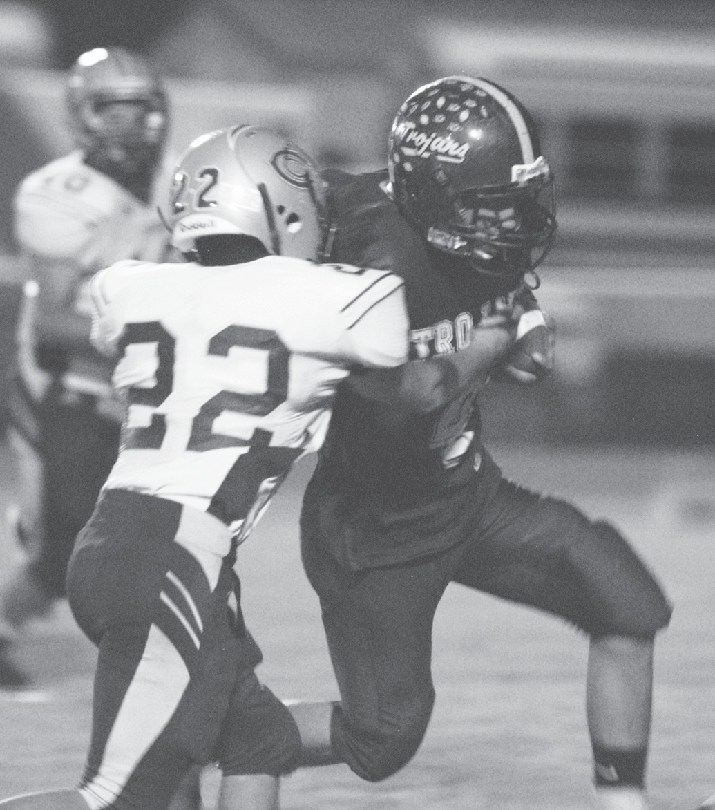 Charlotte's Isaac Santos breaks lose from a Cotulla defender during the Trojans home victory over the Cowboys,