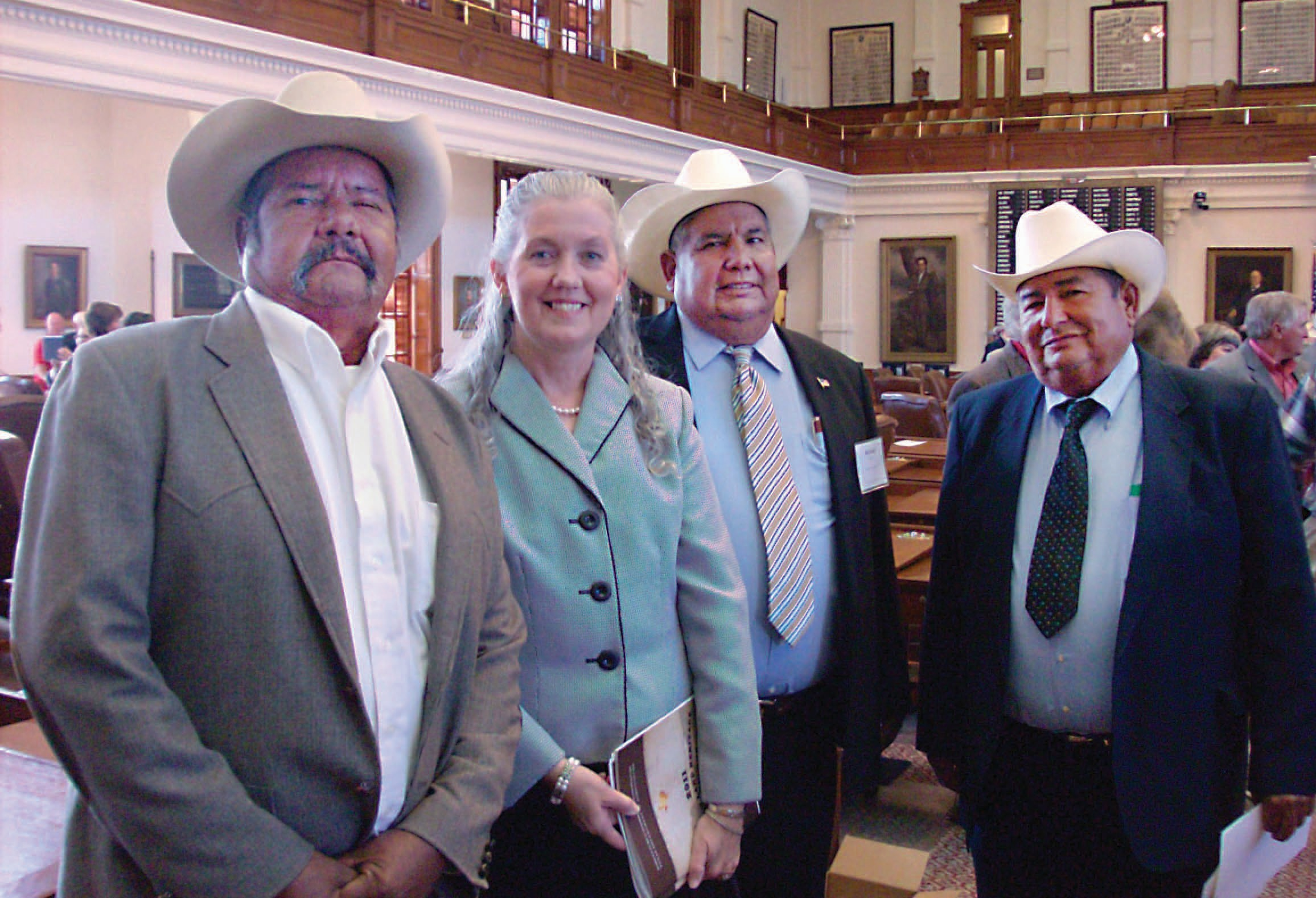 The picture, shortly after the ceremony on the capital floor, has from left to right, David Reyes, County Judge Diana Bautista, Richard Reyes, and Albert Reyes.