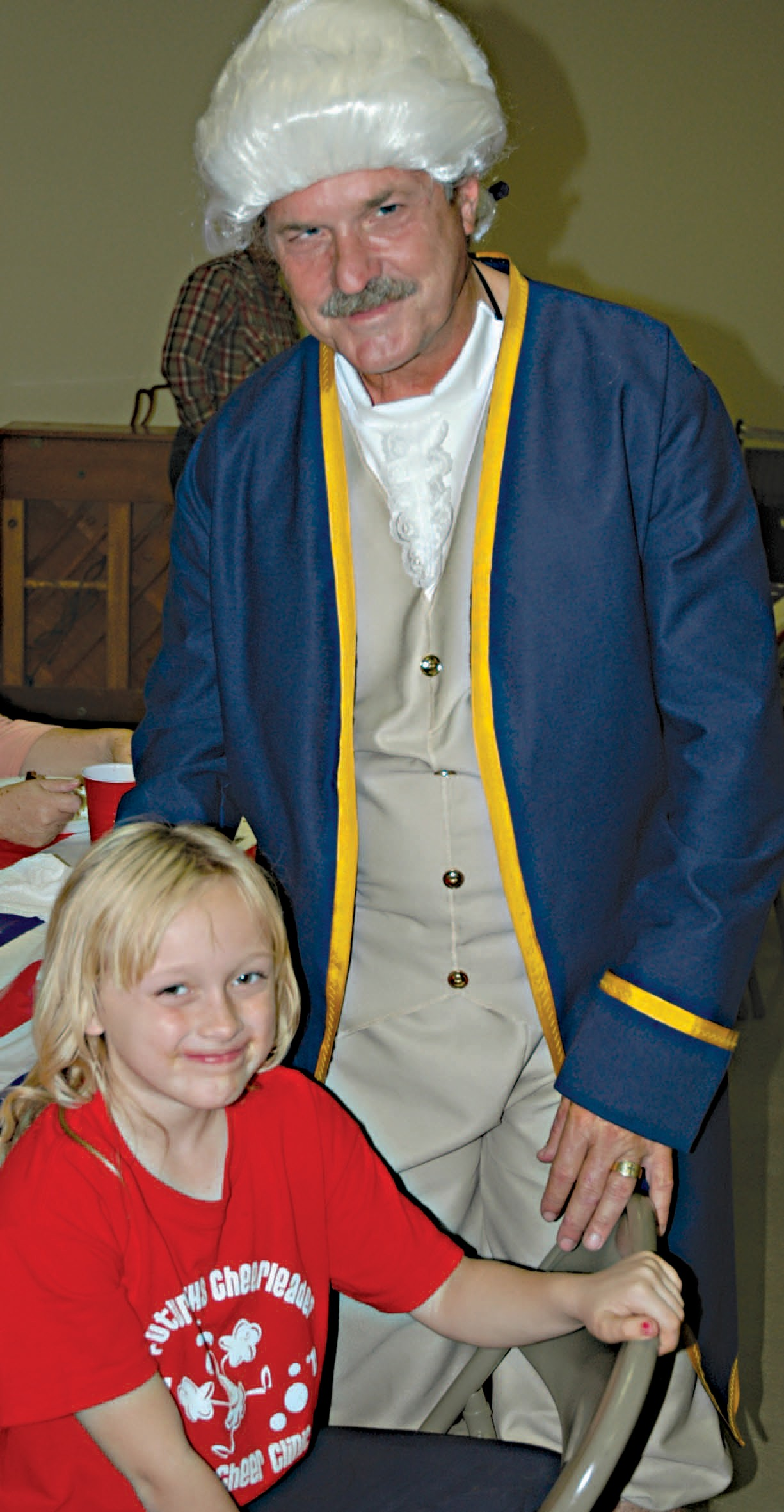 "Star Lenz, age 9, gets a chance to chat with ""George Washington,"" (portrayed by biographer Austin Teutsch). Teutsch was also the guest speaker at the American Legion's Memorial Ceremony in Jourdanton on Veterans Day. The ceremony followed a free spaghetti dinner for American Legion members and the public."