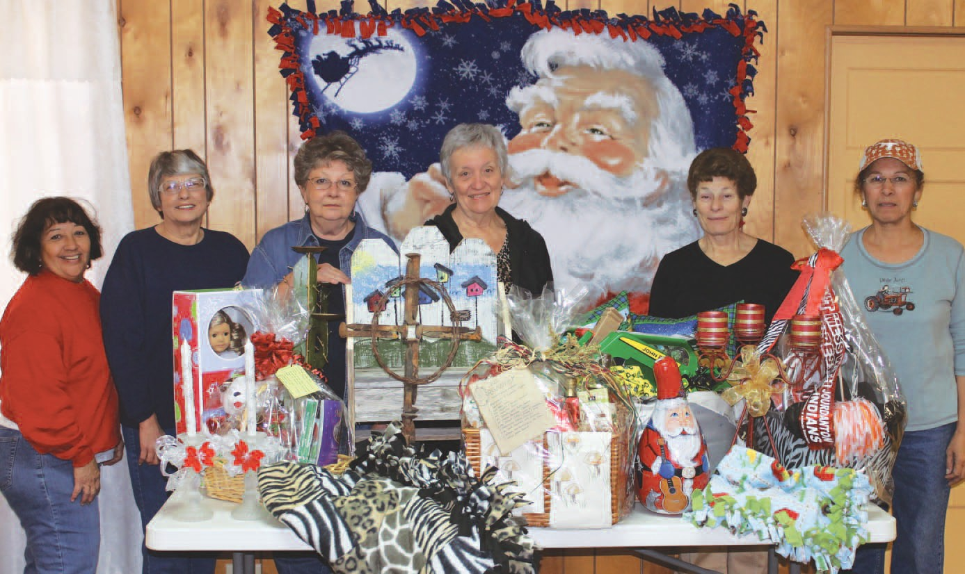 Standing alongside assorted gifts for their church's bazaar and luncheon on Dec. 9 are, left to right: Janie Ayers, Beth Schendel, Gae Garwood, Carol Camber, Katie Schuchman and Paula De La Peña. The event takes place from 11 a.m. to 1:30 p.m. at the Jourdanton Community Center.