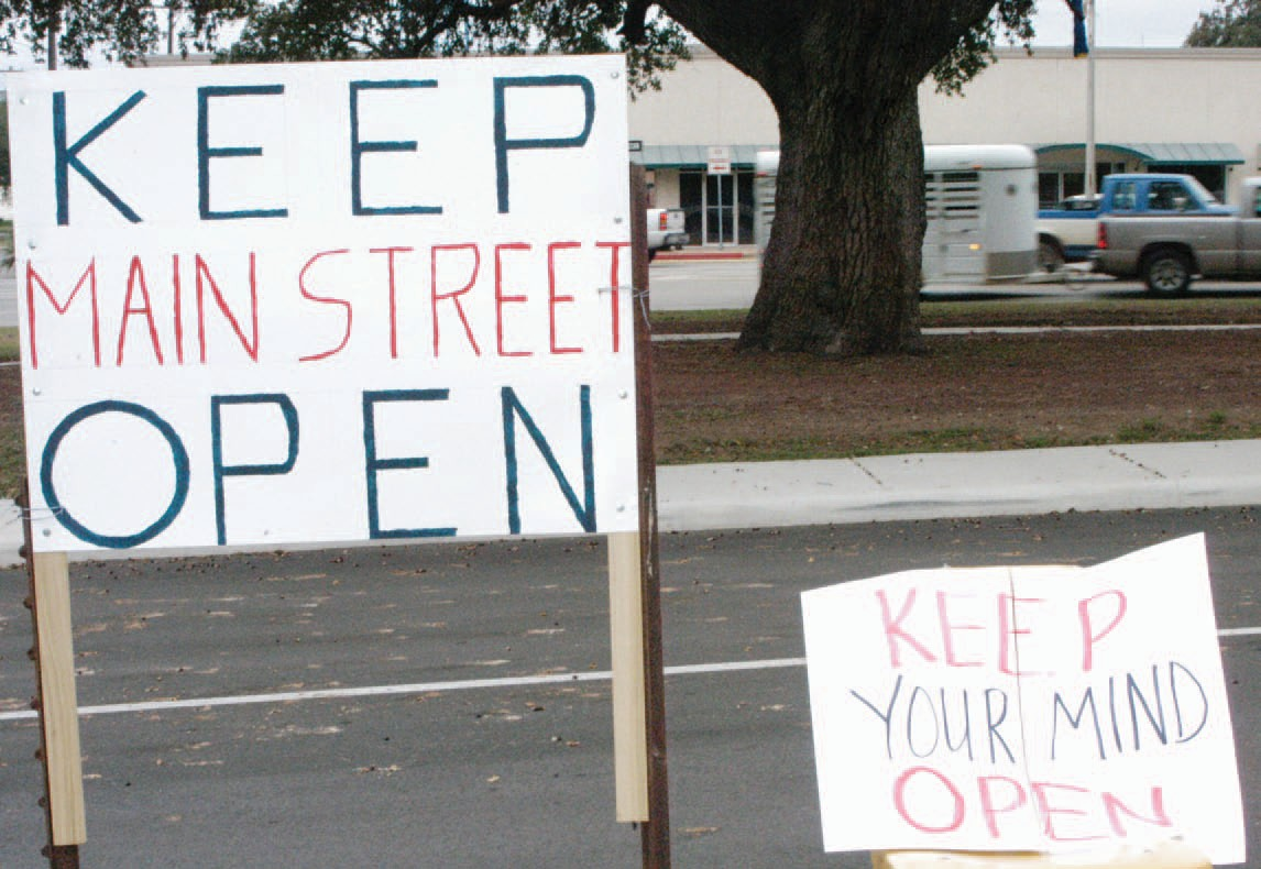 """The sign """"Keep Main Street Open"""" indicates the whole street may close. In reality, the election will decide to accept the originally approved plans which includes a partial closure of Main Street."""