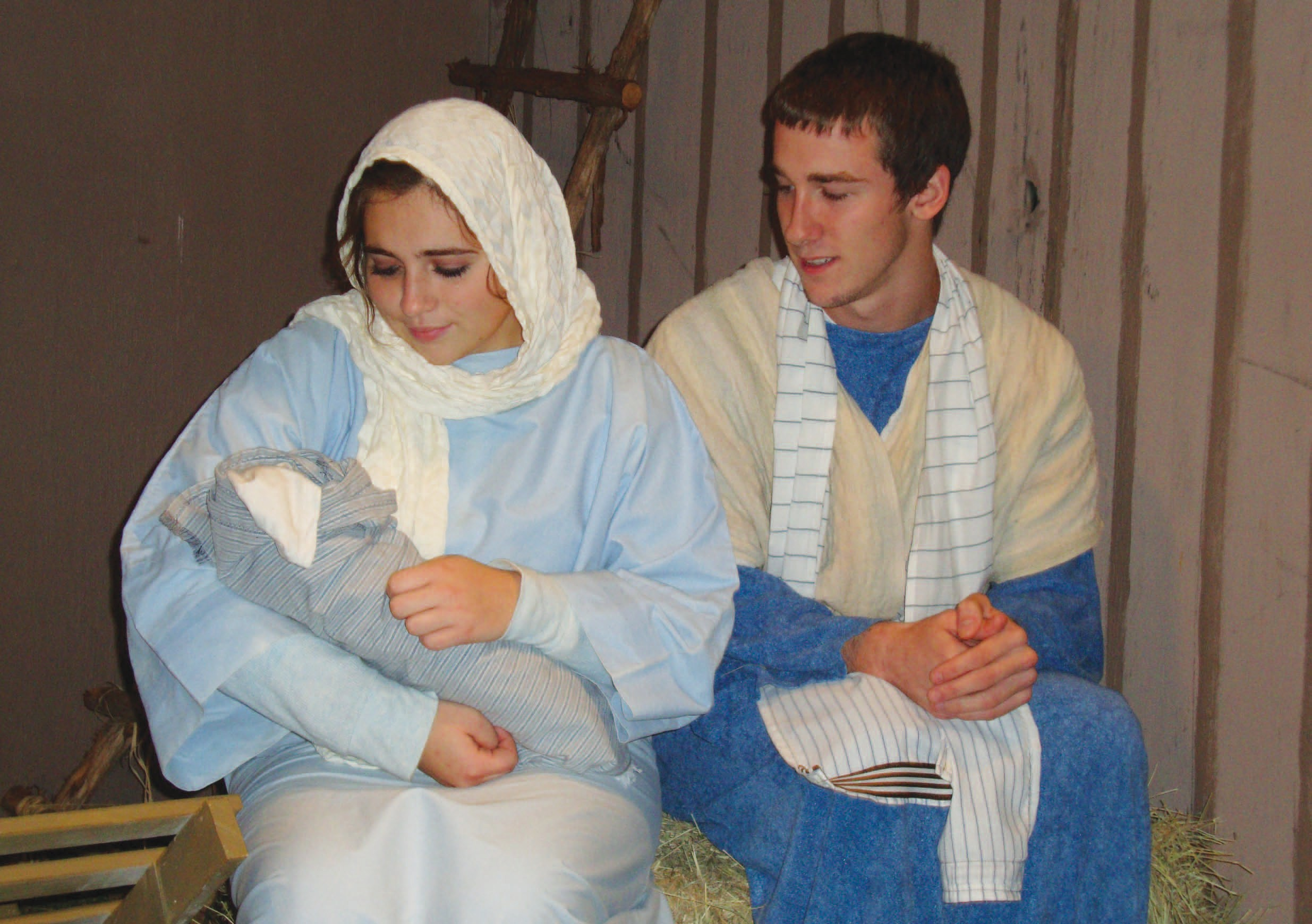 Mary and Joseph welcome the Christ Child (Stephanie Rivera and Garrett McDermott) in the manger scene at The Christmas Village earlier this month. We wish you and yours a joyous Christmas. Please see page 2B for a complete church service schedule.