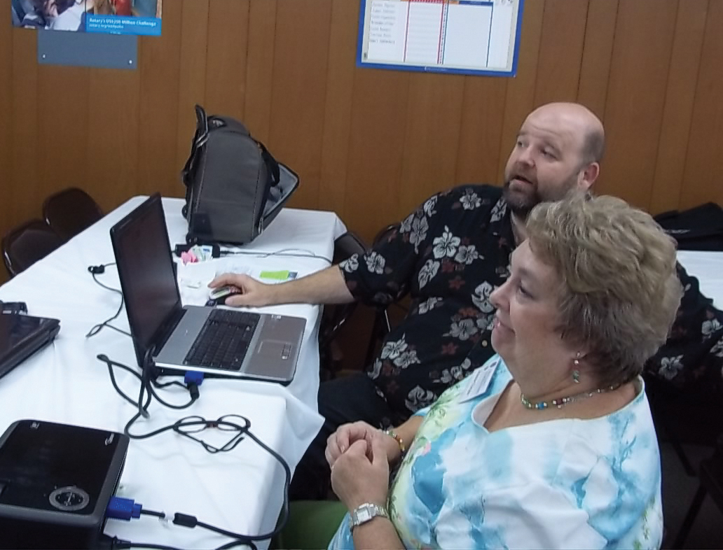 Technology Meeting. Mike Pascarella shows Joanne Torans how to open a Facebook account so she can access Republican legislative websites and candidate websites while they were at the February meeting of Brush Country Republican Women.