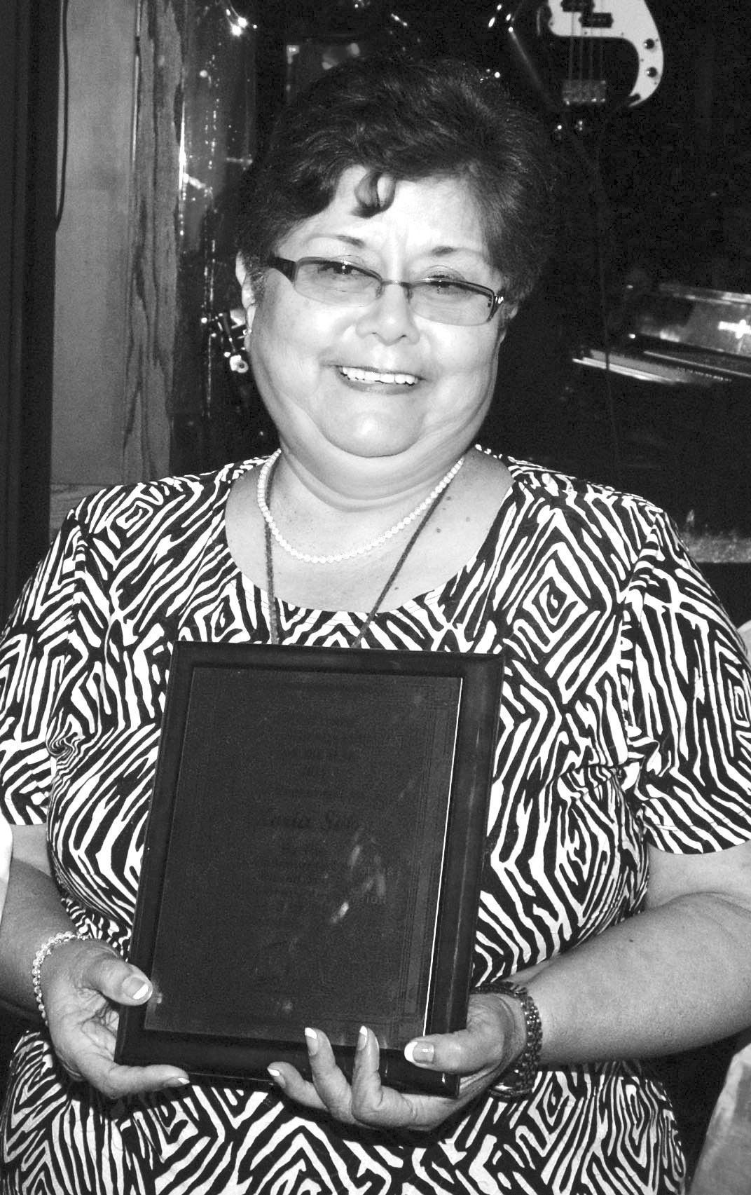 Gloria Solis was awarded Librarian of the Year by the Small Community Library Roundtable.