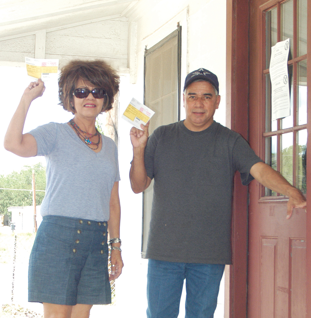 Jane Griego and Sammy Mejia proudly show their voter cards as they go to vote.
