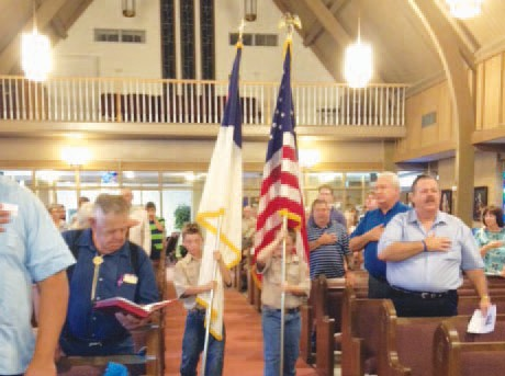 Webelos II Scout Kadyn Temple (left) from Pack 194 and Boy Scout Danny Morrison II (right) from Troop 194 presented the Colors as part of the Memorial Day service at the Pleasanton First United Methodist Church on Sunday, May 27, 2012 as the congregation sang the National Anthem. The Scouts also lead the congregation in the Pledge of Allegiance to the United States and Christian Flags.