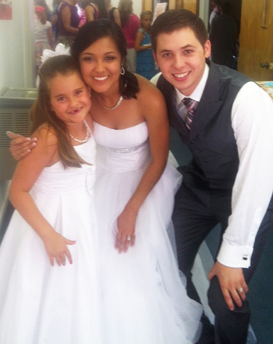 Mr. and Mrs. Mayberry with flowergirl McKinley.