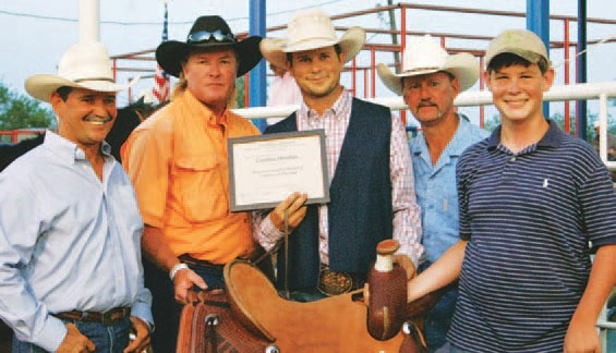 Last year Cuatro Hindes (center) was named Working Cowboy of the Year at the Pleasanton Young Farmers' Rodeo. Joel McDaniel, Cowboy Selection Chairman, Ty Reich, PYF, Allen Janecek PYF President and Gus Wheeler presented the hand tooled saddle sponsored by Atascosa Livestock Exchange. Nominations are due by July 27 for the 2012 Working Cowboy of the Year and inductee(s) to the South Texas Cowboy Hall of Fame.