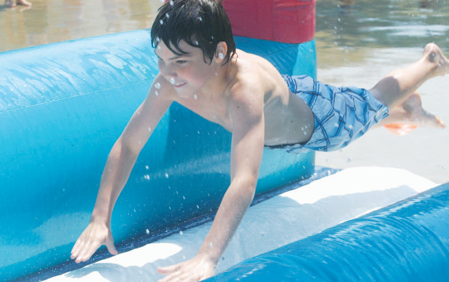 Brandt Behrens of Pleasanton enjoys catching some air on a water slide during a Vacation Bible School playday at First Baptist Church in Pleasanton.