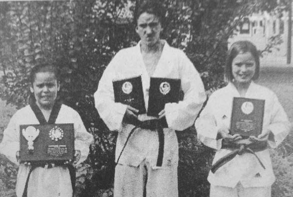 Danica Tello, Ike Malone and Ashley Sewell, featured in Flashback's 10 Years Ago timeline, show off the trophies they won as students of Tri City Tae Kwon Do Dojang at a martial tournament in San Antonio.