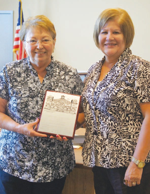 Retiring Assistant Chief Deputy Clerk Carolyn Tatum (left) was honored with a plaque at the last Atascosa County Commissioner's Court meeting for her 28 years of service. At right is County Clerk Diane Gonzales.