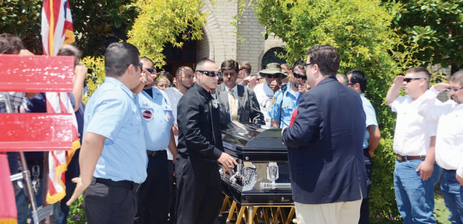 Atascosa County Volunteer Firefighters and mourners flank the sides of the recessional of the funerals of Jeremy Ward and Sarah Luna on Saturday, August 4. Many family and friends attended to pay their last respects to the beloved couple and community minded leaders. The tragic accident that took their lives is still under investigation.