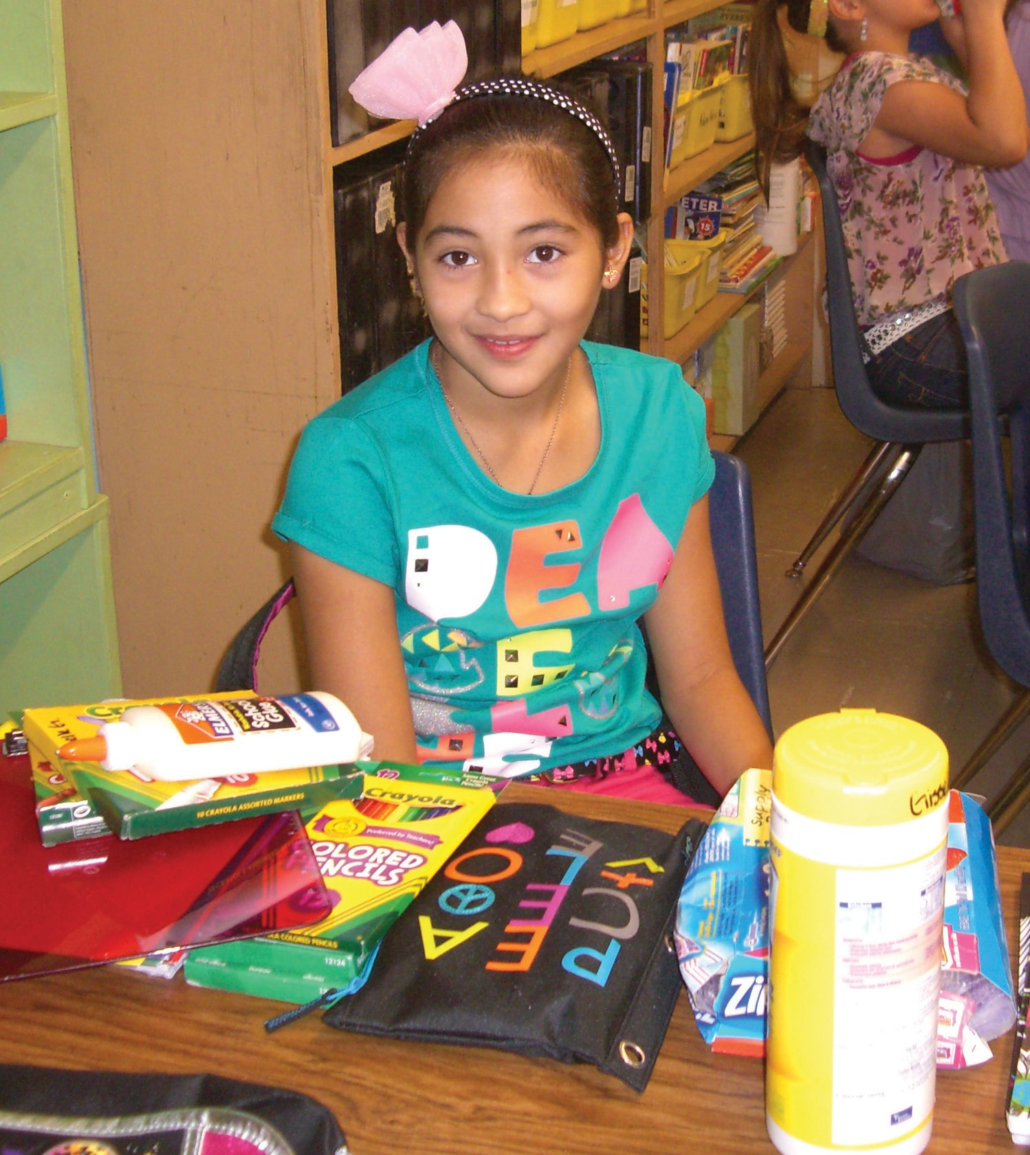 Gisselle Garcia, a fourth grader at Jourdanton Elementary School, takes out her school supplies to prepare for the new school year. Classes started throughout the Brush Country on Aug. 27. Garcia is a student in Ms. Marylou Chandler's class.