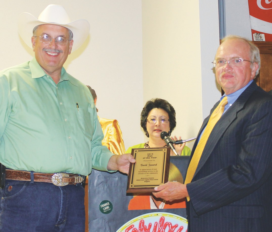 Man of the Year, David Soward, was given his plaque by Bill Schuchman, representing the American Legion, at the Jourdanton Chamber of Commerce banquet.