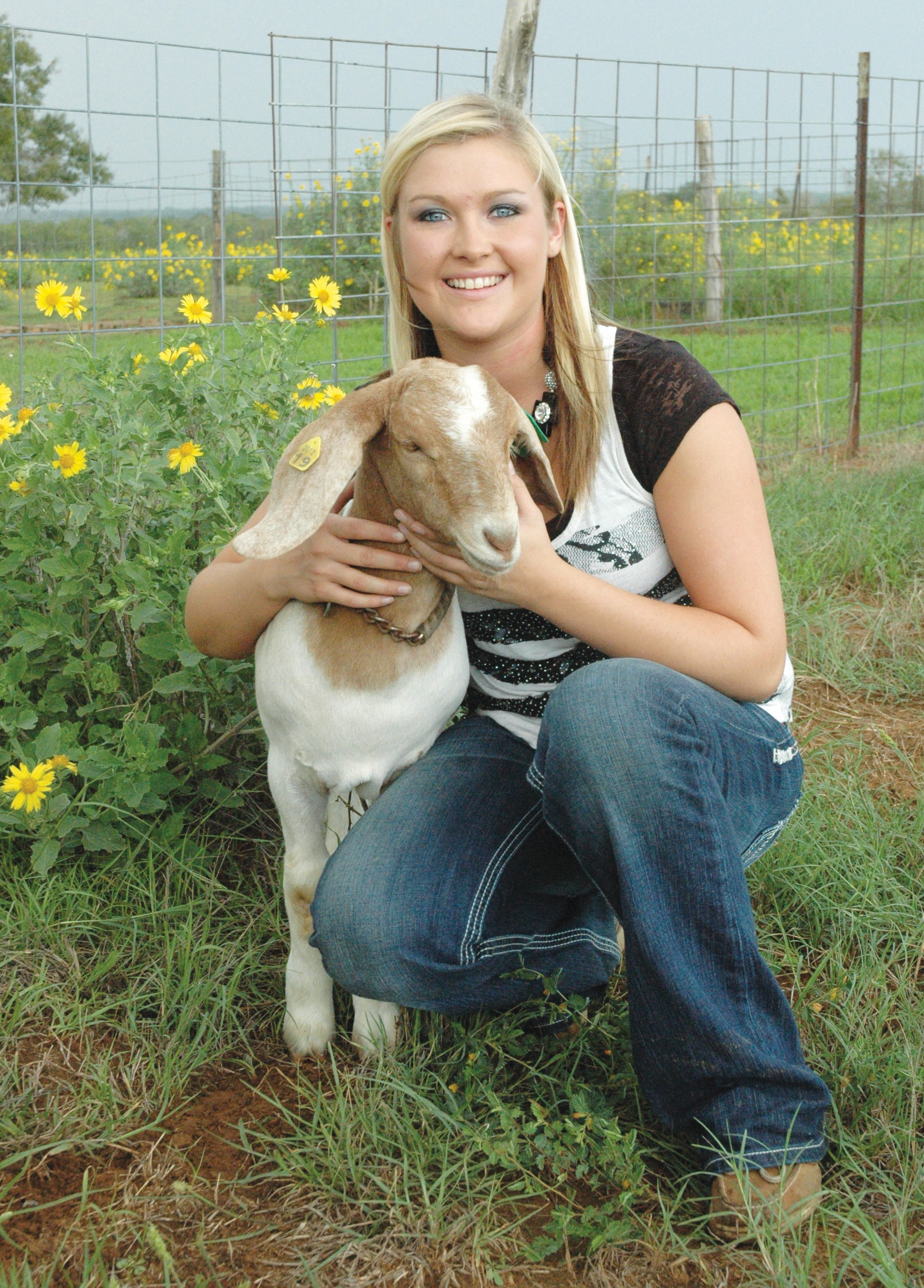 """Kayla Wilkins, a senior at Poteet High School and FFA President, is getting her show goat """"Spanky"""" ready for the Atascosa County Fair this Saturday and Sunday, October 6 and 7. A dance featuring Zach Edwards Band with Billy Hanson and the Lone Strangers opening will begin at 7:30. Dance admission is $10.00 at the gate. See story on page 2."""
