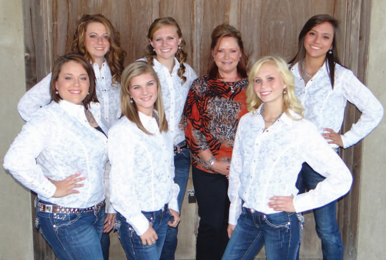 Jill Reed of City Cleaners (center) has donated dry cleaning for the Cowboy Homecoming Court . Gathered around her are back row, left to right: Princess Emalee Rice, Princess Jessica Herschap, Reed and Princess Danielle Santos. Front row, left to right are Duchess Kylie Yapp, Queen Kianne Rowinsky and Princess Lexie Roane.
