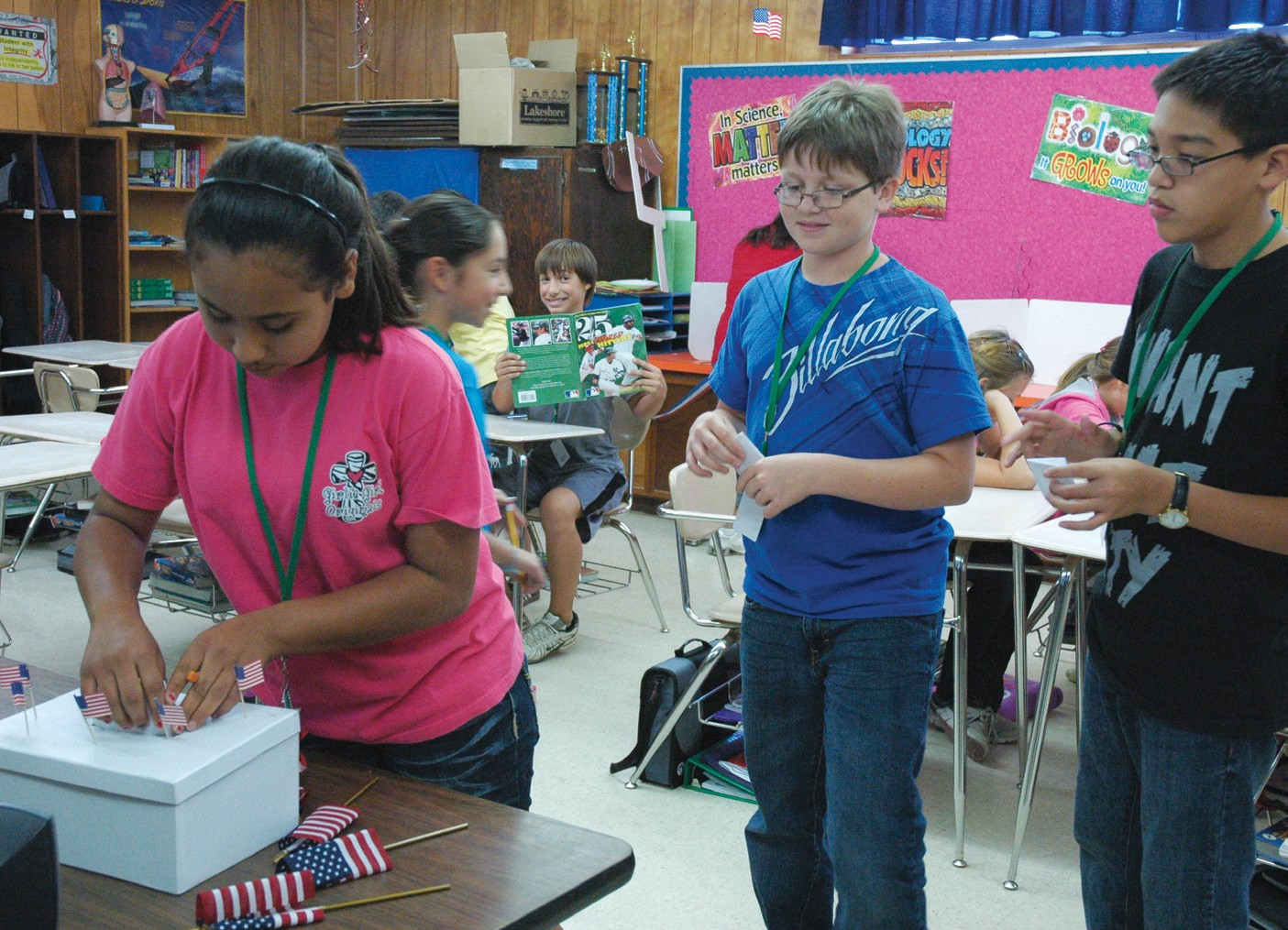 The Pleasanton Intermediate Campus sixth graders held a mock presidential election on Tuesday, November 6. Bethany Douglas places her ballot in the voting box in Ginger Niemietz' 6th grade class as Travis Minnear and Thomas Villalobos wait their turn.