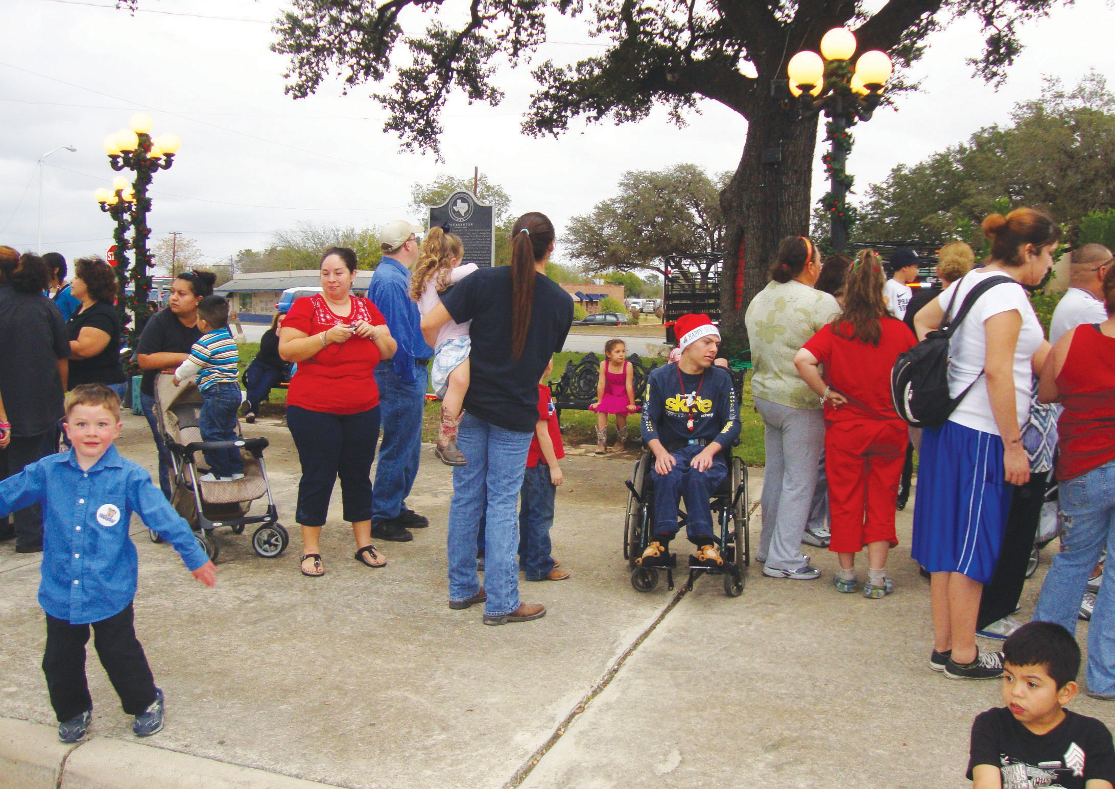 Children lined up for their visit with Santa Claus at last year's Brush Country Christmas in downtown Pleasanton. The event will be held this Saturday, December 1 starting at 3:30.