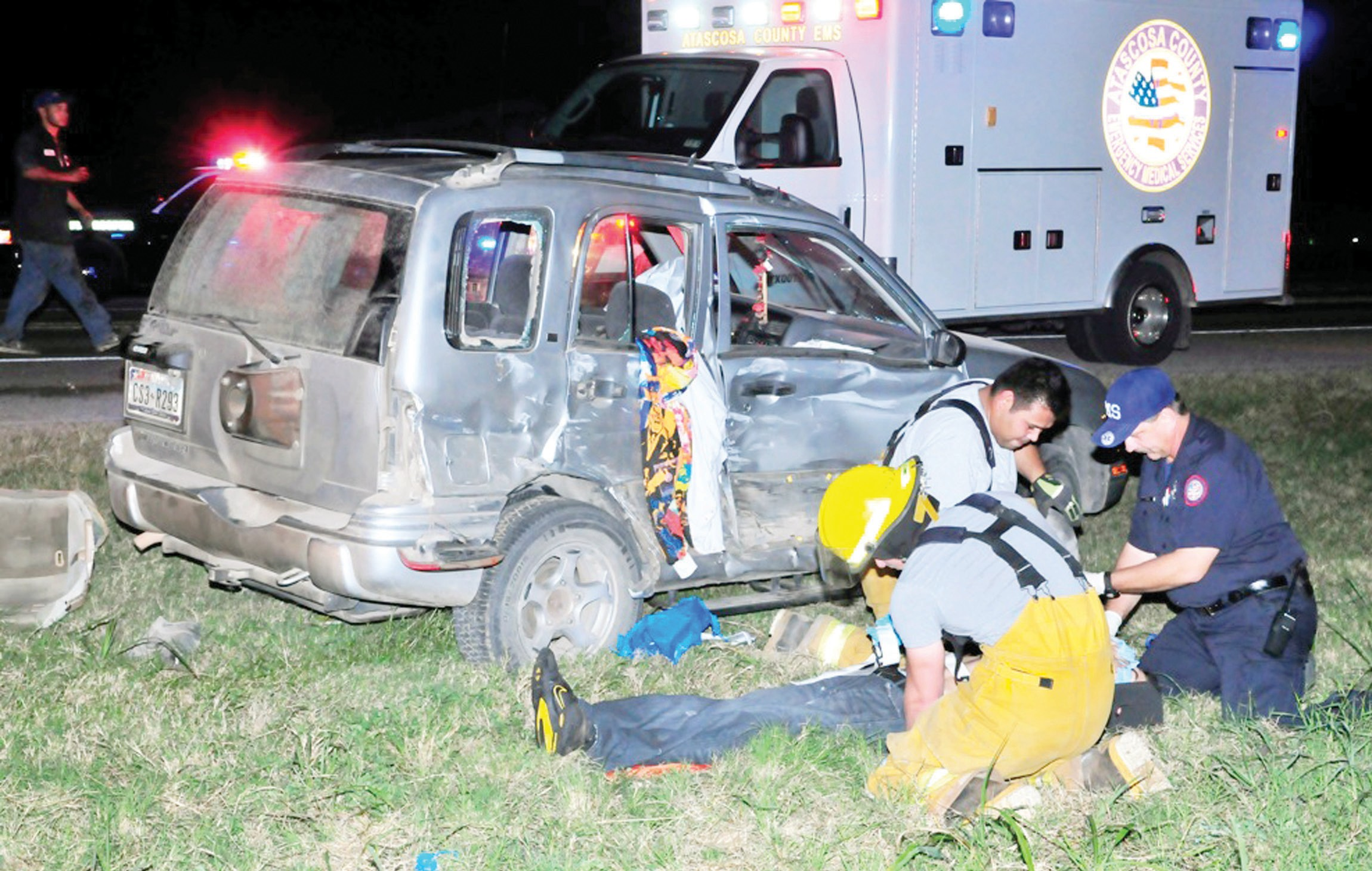 Emergency workers tend to 7-year-old Jade Romero after a crash on Hwy. 97 in Charlotte. Romero was taken to University Hospital by AirLife and the driver,Edwin Miranda and passengers Evan Romero and Clemencia Calvillo to South Texas Regional Medical Center. The accident occurred around 7 p.m. on Tuesday.
