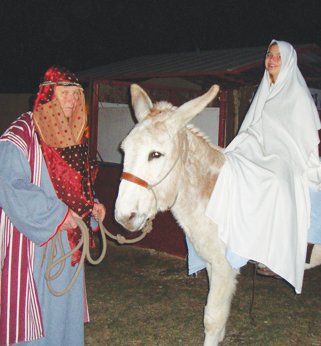 Mary and Joseph make their way to Bethlehem during a scene portrayed at the Christmas Village last year. It will be presented this Friday, Saturday and Sunday at the Poteet Strawberry Festival grounds.