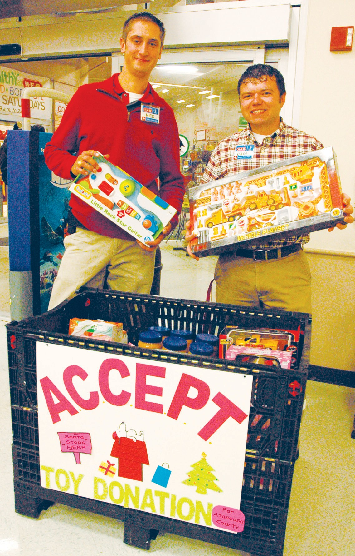 Nick Hudek, HEB Store Director and Carl Banta HEB Central Checkout Manager encourage everyone to donate to ACCEPT this Christmas season. They are accepting toy and food donations at their store located at 219 W. Oaklawn.