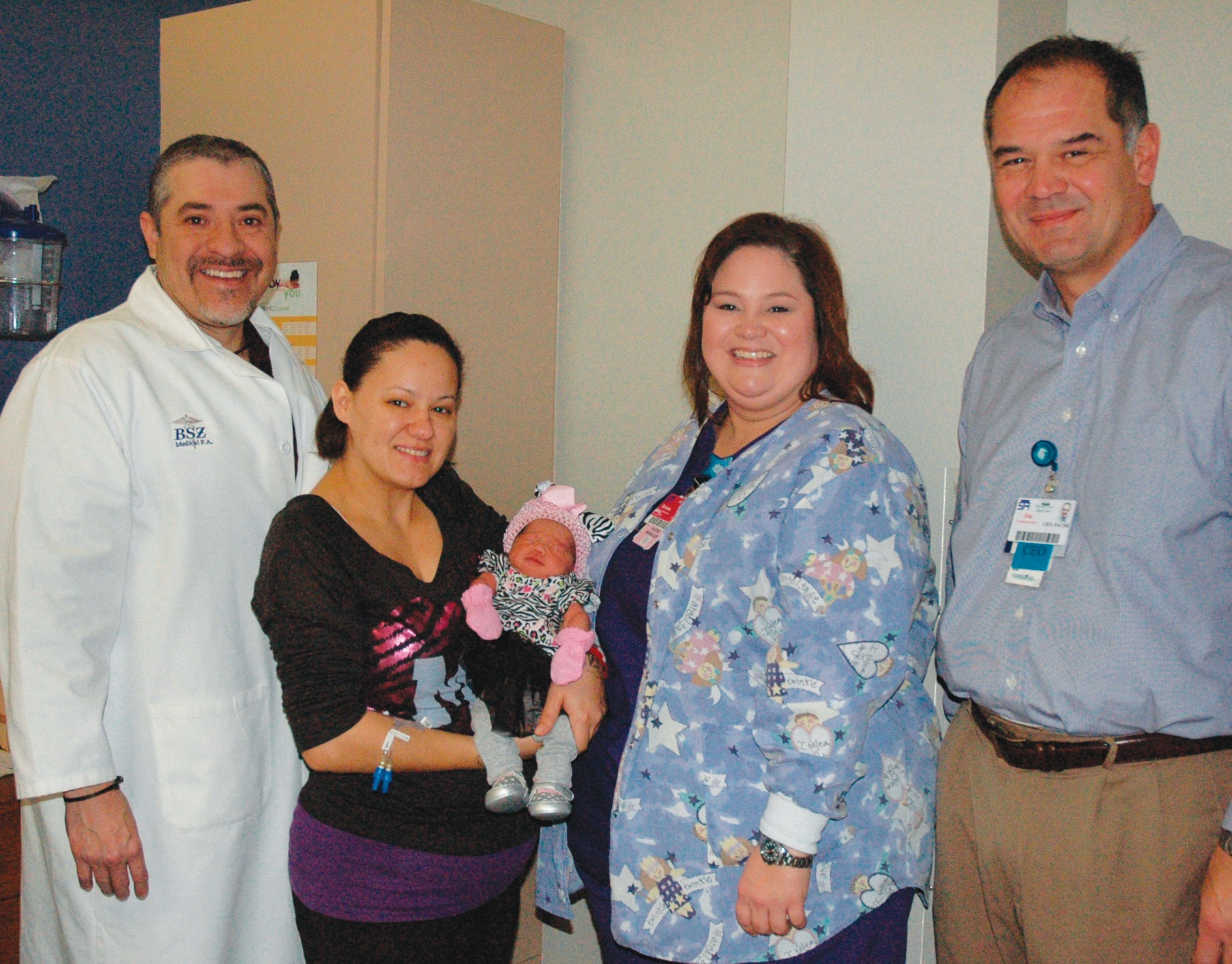 """South Texas Regional Medical Center welcomed their First Baby of 2013 on January 2. Dr. Benjamin S. Zertuche delivered Isela Love Rodriguez at 1:10 p.m.. She weighed six pounds and one ounce and was 20.5"""" long. Parents are Rusela Marie Lopez and Anthony Rodriguez. Isela has two big brothers– Teagan Henry Torres and Zayden Jay Lopez – waiting to greet her. Left to right are Dr. Zertuche, Rusela with Isela, Deanna Hughes, Assistant Director of Nursing and Jim Resendez, STRMC Chief Executive Officer."""