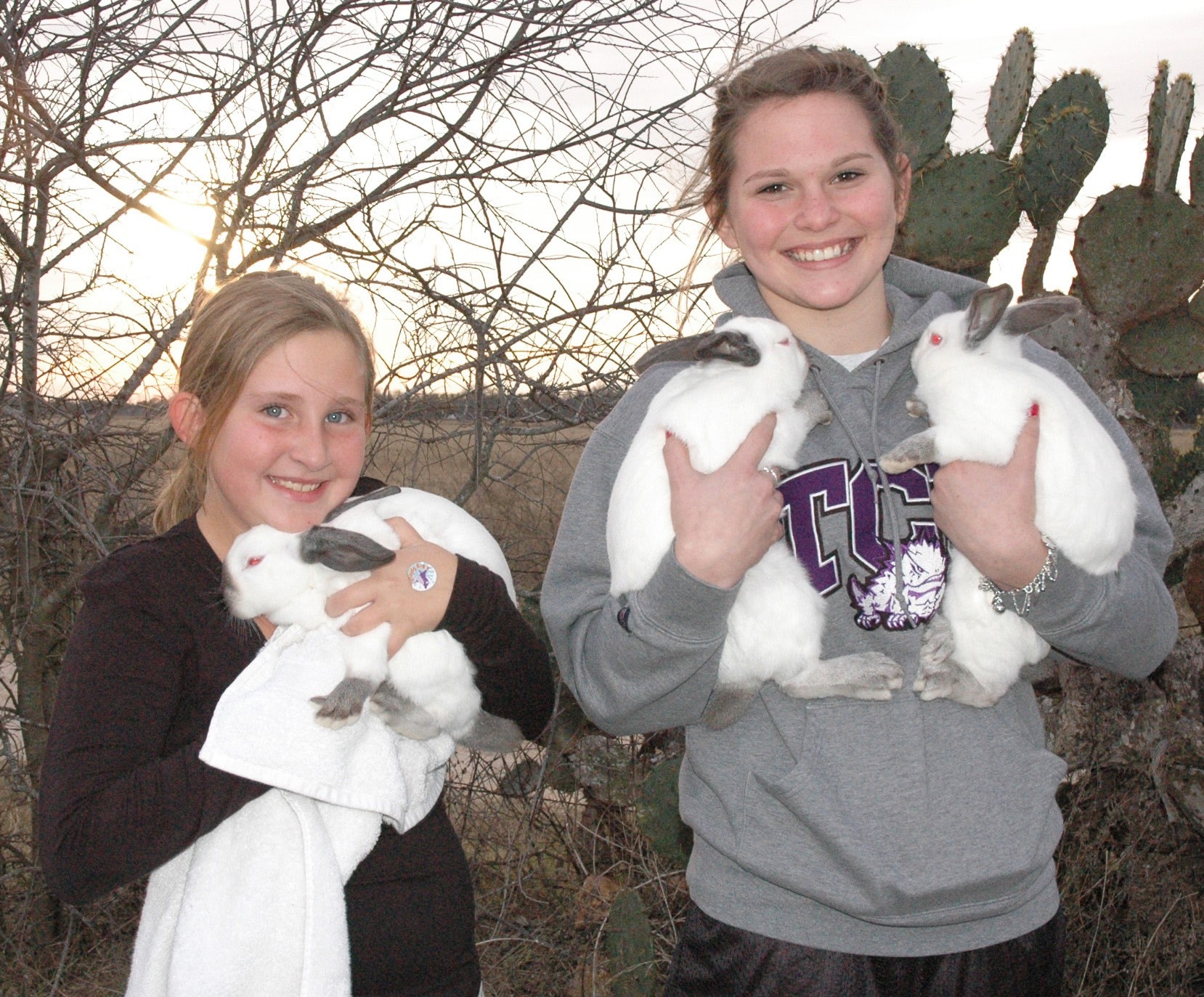 """Siblings Kendall Niemietz (9 years old) and freshman Tori Jasik are ready for the Atascosa County Junior Livestock Show. Their rabbits, """"Buggers"""", """"Spot"""" and """"Snowball"""" were shown on Tuesday. They are members of Pleasanton FFA. Judging continues this week with the big auction at 1 p.m. this Saturday."""