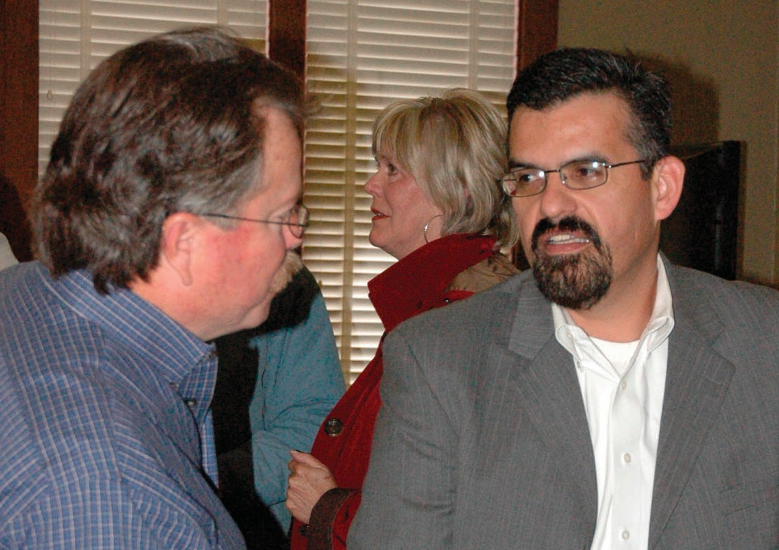 Warren Wheeler (left) discusses the realigned hours of the Tilden Post Office with Postal Manager Daniel Reyes.