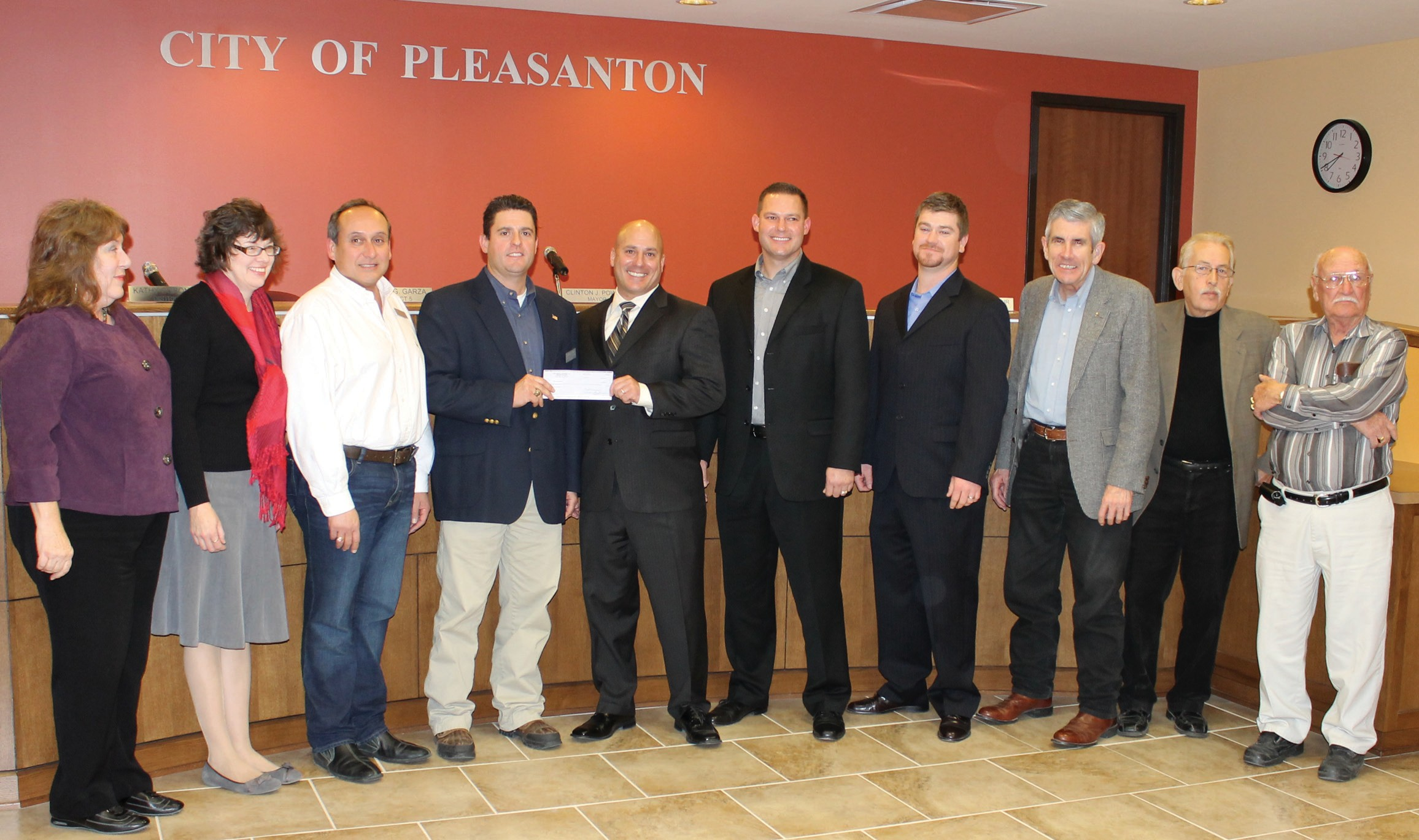 Representatives with RCW Energy Services present a $10,000 check to Pleasanton City Council for the Pleasanton Community Center and Library. Left to right are: Pleasanton Councilmembers Jeanne B. Israel, Kathy Coronado, J.R. Gallegos, Mayor Clinton J. Powell, Glenn Young, RCW Energy Services President; Brian Green, RCW Senior Vice President- Operations; Erik Schaal, RCW Regional Operations Manager; Councilmembers Jimmy Magel, Roger G. Garza and Abraham Saenz.