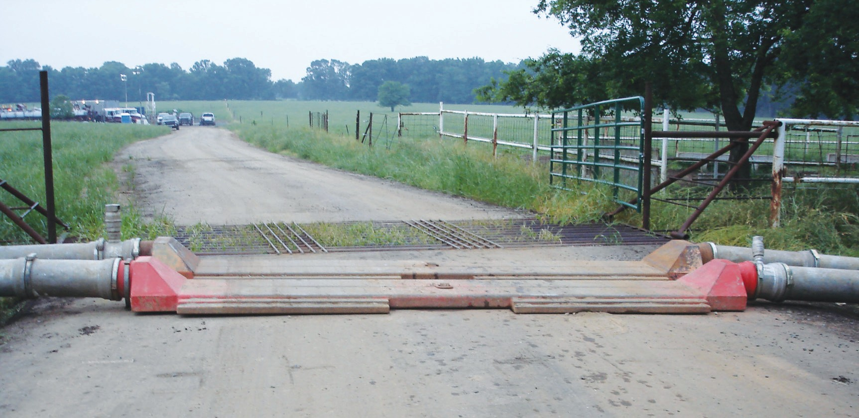 Another good example of RCW's water transfer pipe running across a cattle guard road crossing.
