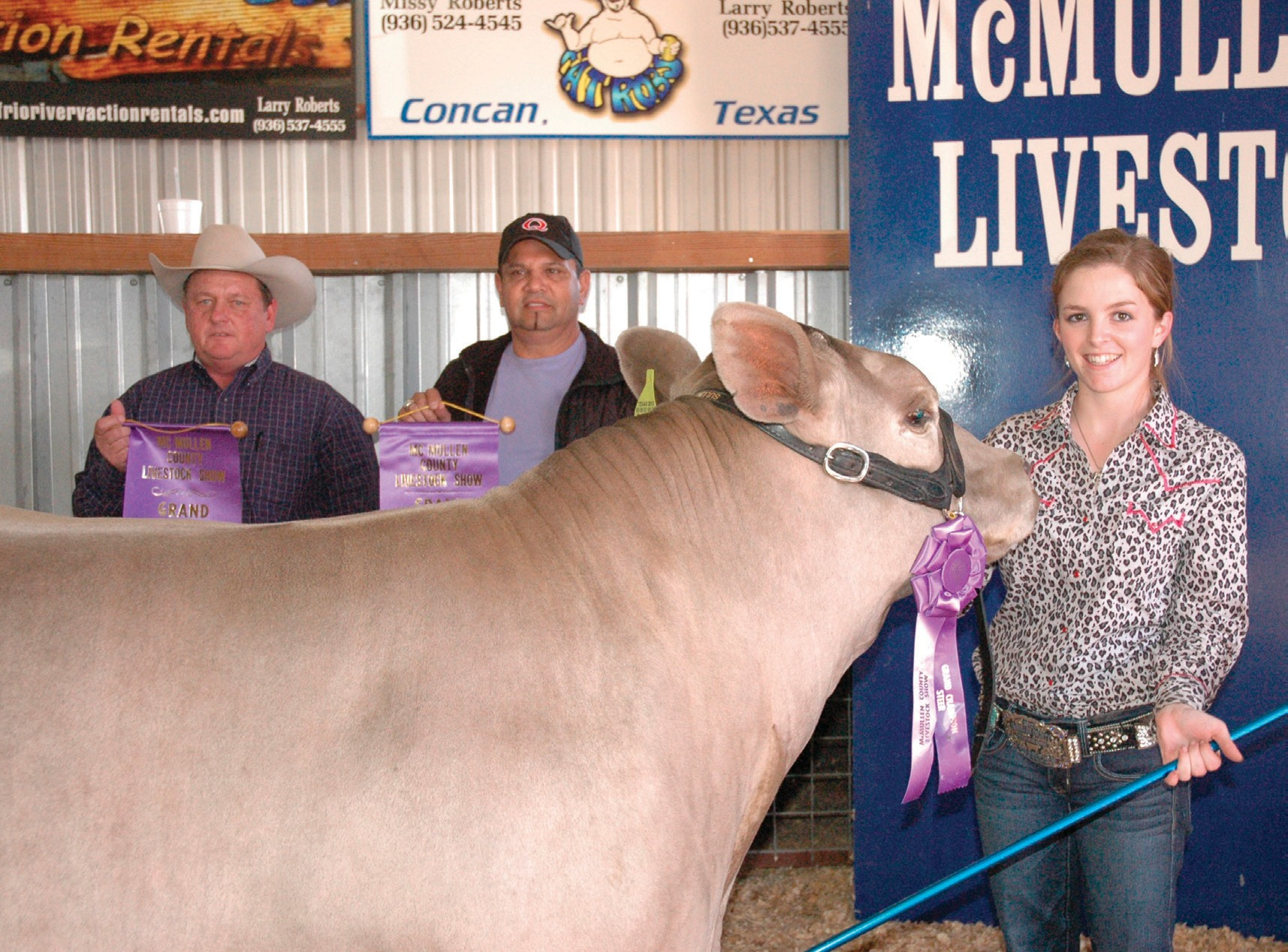The McMullen County Livestock Show Grand Champion Steer was awarded to Ashely Lewis. Jody johnson (left) of Strike Construction and Leo Quintanilla (middle) of Q Haul bought it for $13,000, up $3,000 from 2012.