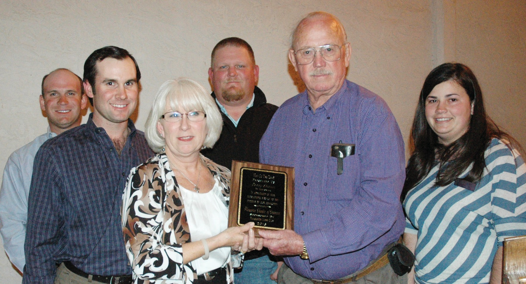 Matthew, Wesley and Sharon Shearrer (from left)accept the Man of the Year award in memory of their father and husband, Tommy Shearrer, from Lions Club member Wilbur Palmer. Chamber 1st Vice President Wade McBee and 2nd Vice President Candace Vrana assist.