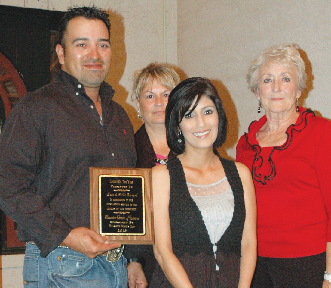 Gilda and Lupe Rangel were named Couple of the Year at the ceremony. Patsy Troell of Pleasanton Woman's Club (far right) presents the award along with Chamber Director Kellie Vrana (back).