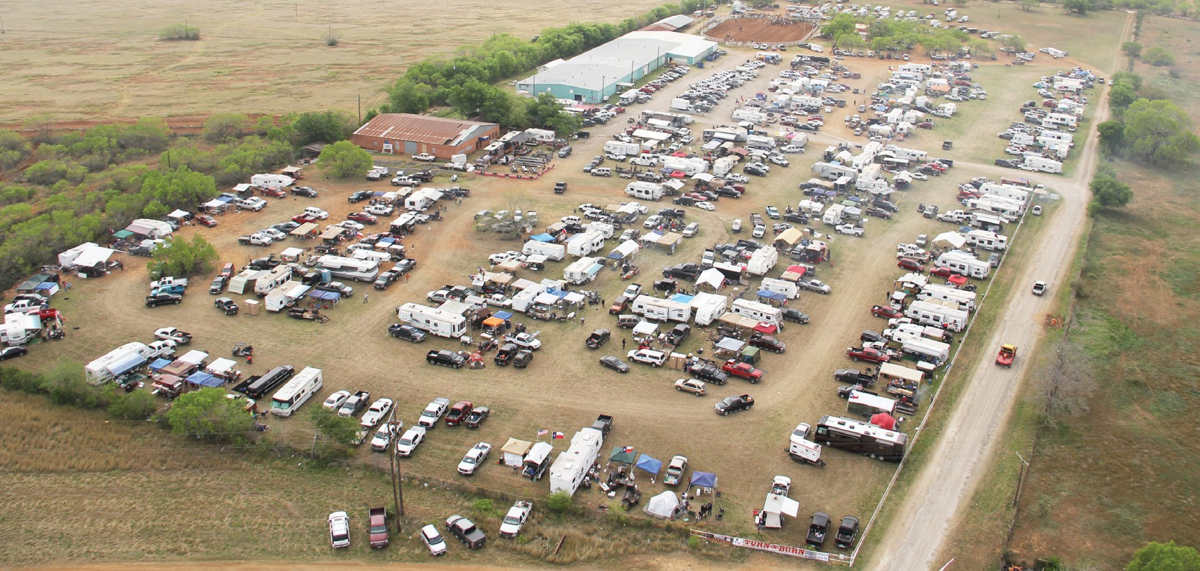 Top Photo: A panoramic photo showing the BBQ cookers at pre-awards time this past weekend. Above Photo: The Atascosa County Showbarn grounds were wall-to-wall barbeque cookers at the Pleasanton Chamber of Commerce Third Annual Turn-N-Burn Cook-off held last weekend. A record breaking 149 teams participated in the event.