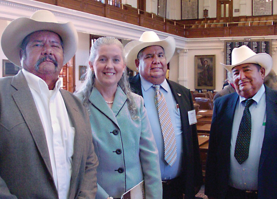 Richard Reyes (second from right) is pictured with Atascosa County Judge Diana Bautista and his brothers David and Albert Reyes at the State Capitol. The family was honored for more than 100 years of active agriculture on their farmland from the State of Texas in November 2011.