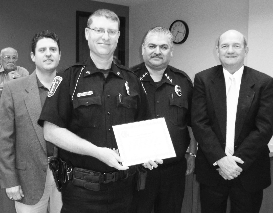 Officer David Gardner received a certificate for his efforts to use his training to catch drug traffickers. Mayor Clint Powell, Chief Ronald Sanchez and City Manager Bruce Pearson congratulate Officer Gardner.