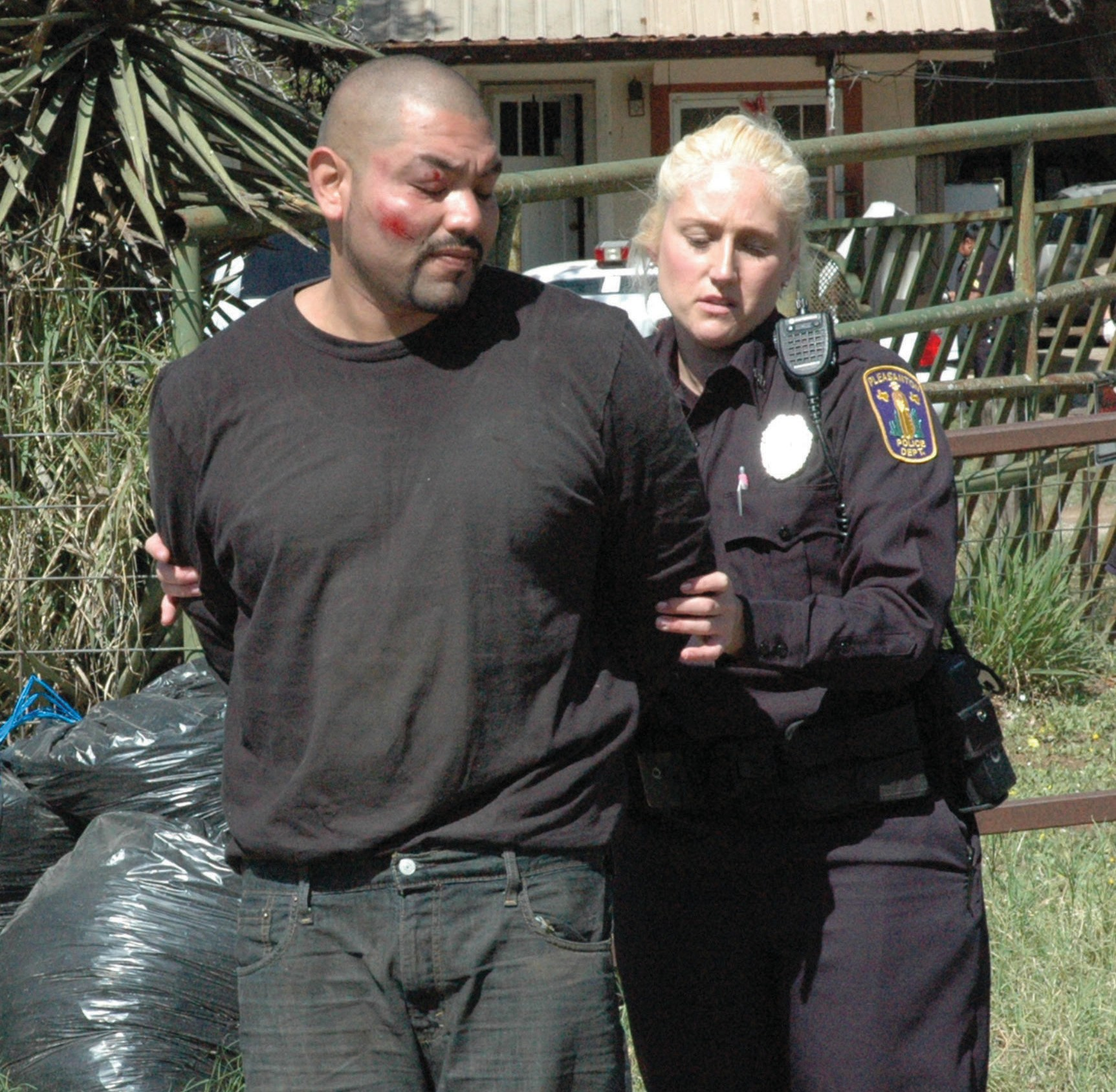 Alejandro Guerra, 29, is taken into custody by Pleasanton Police Officer Jessi Mertz. Guerra was charged with possession of a controlled substance, Methamphetamine.