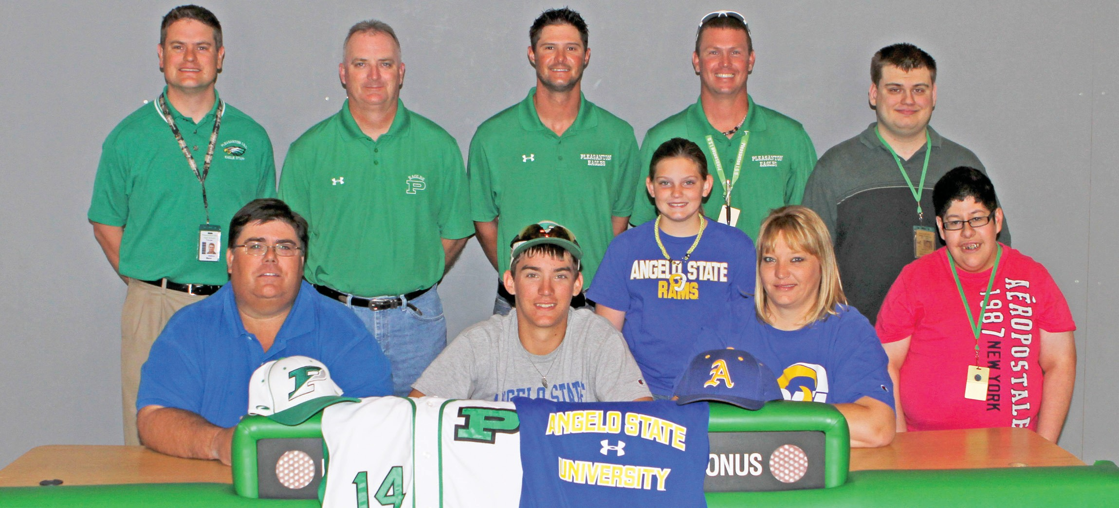 Matt Shannon (center), along with his family and coaches smiles before signing his letter of intent to play baseball at Angelo State University this week. Pictured next to him are: parents Joe and Tammy Shannon. Behind is his sister Kaycie. Back row: Principal Dr. Mann, Pleasanton Athletic Director Tab Dumont, Assistant Baseball Coach Bruce Schorsch, Head Baseball Coach Chris Ingram, Ryan Jaloway and JP Garcia.