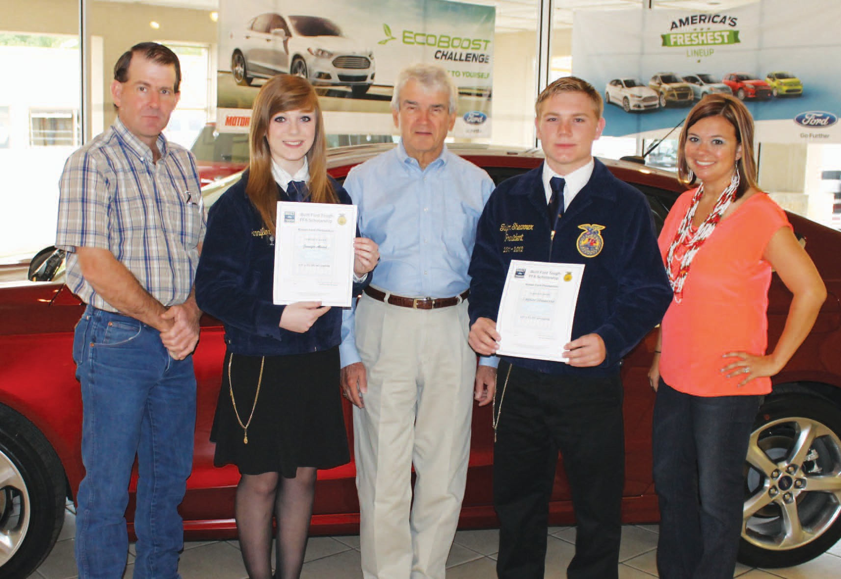 Jennifer Alvord and Taylor Shearrer were each recipients of a Built Ford Tough Scholarship. Pictured left to right are John Lanier, Jourdanton FFA Advisor, Jennifer Alvord, Bob Kinsel, Taylor Shearrer and Amanda Hargrove, Pleasanton FFA Advisor.
