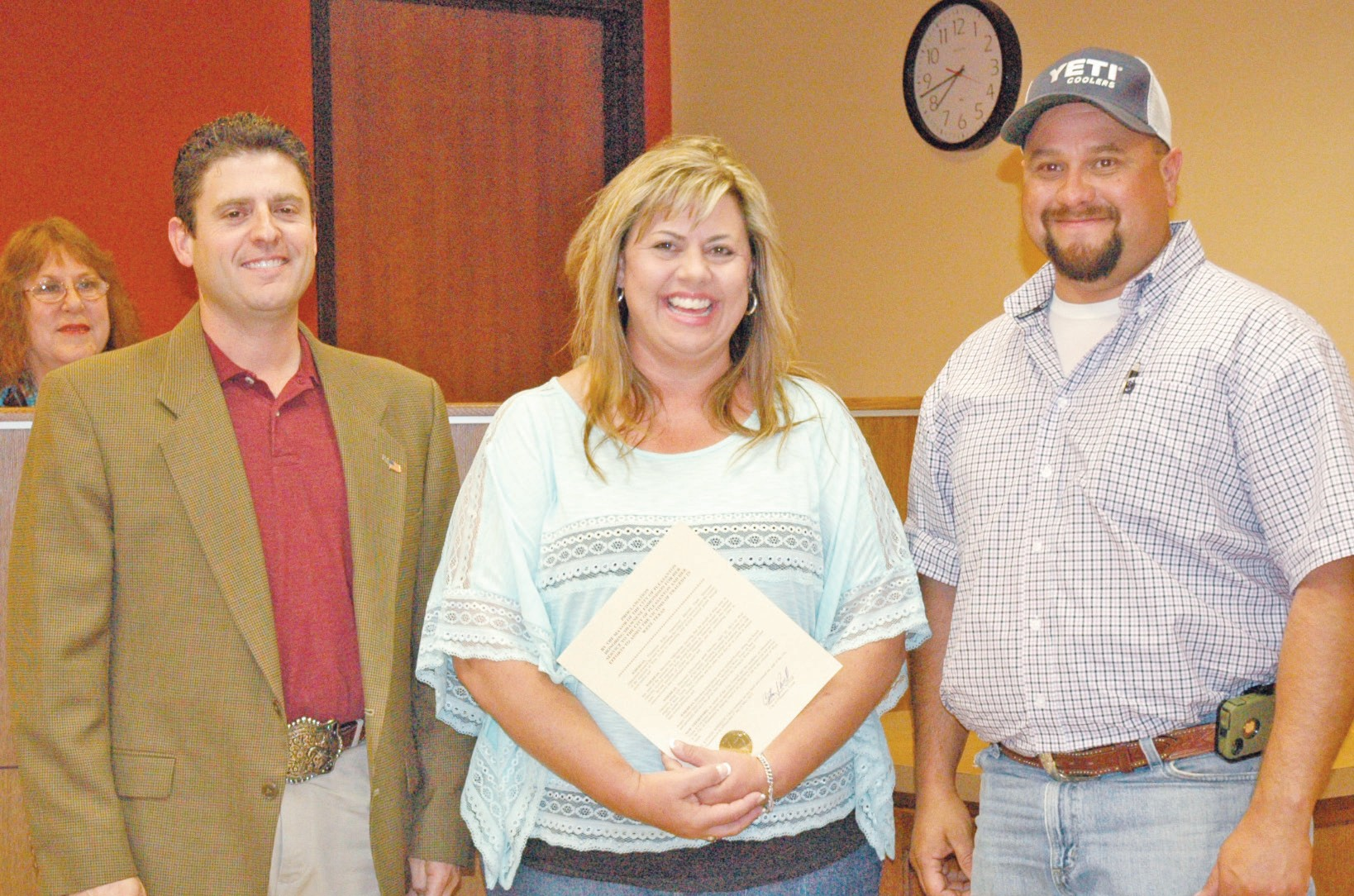 Shawnene Edmondson (center) was presented a special proclamation from City of Pleasanton Mayor Clint Powell (left) at the May 1 City Council Special Meeting. Edmondson was the driving force for collecting items to be transported to the town of West, Texas after the recent explosion. David Douglas (right) of Ranchscapes donated the use of his trailer, truck, fuel and time to deliver to the citizens in need.