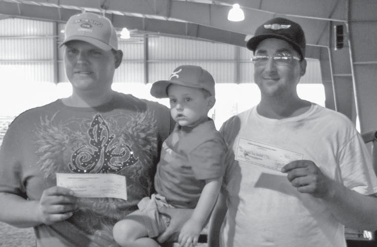 Proud winners of the #12 Team Roping, Brandon Fischer and Grant Schneider, were happy to accept their portion of the $10,000 Cowboy Fellowship Rope Off prize money.
