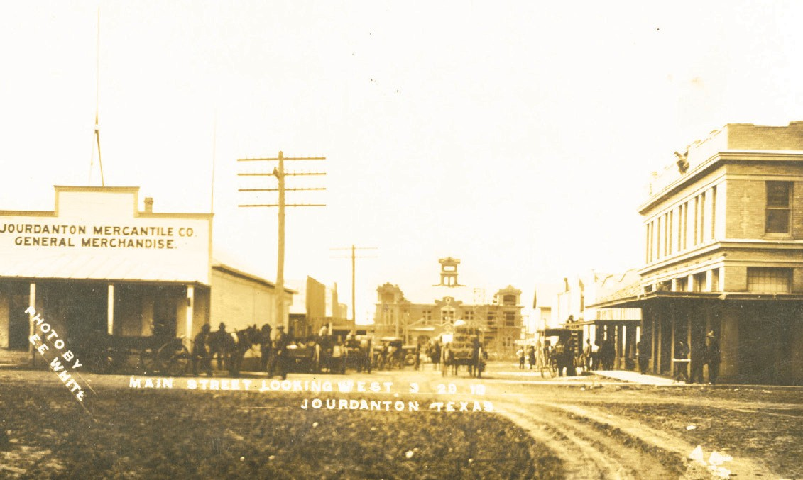The Atascsoa County Courthouse at its completion in 1913 as viewed from the north end of Main Street in Jourdanton. County Officials for 1912-1913 were William M. Abernathy, County Judge; Walter E. Jones, County Judge; Thomas D. Harrison, William Krisch, Edward B. Fern, W. J. Campbell, J. W. Crouch, William Stanush, William F. M. Ross, County Commissioners; Walter E. Jones, County Attorney, J. Rodney Garnand, County Attorney; L. Mogan Willams, County Clerk; Hiram Allen, County Clerk; J. H. Winn, County Sheriff; T. L. Richardson, County Tax Collector; Thomas R. Brite, County Tax Collector; James E. Lyons, County Tax Assessor; Hugh L. McKenzie, County Treasurer.