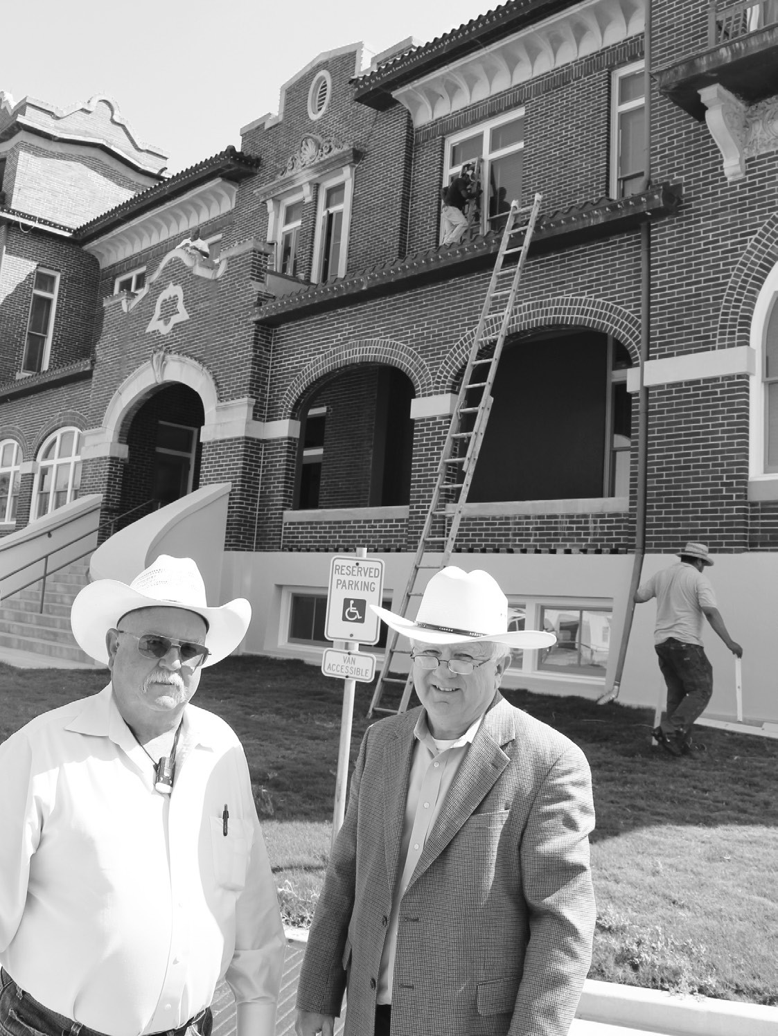 From left, Atascosa County Commissioner Lonnie Gillespie and County Auditor Ray Samson are standing on the west side of the Atascosa County Courthouse in Jourdanton that's undergoing needed maintenance. Both Gillespie and Samson have been overseeing the project.
