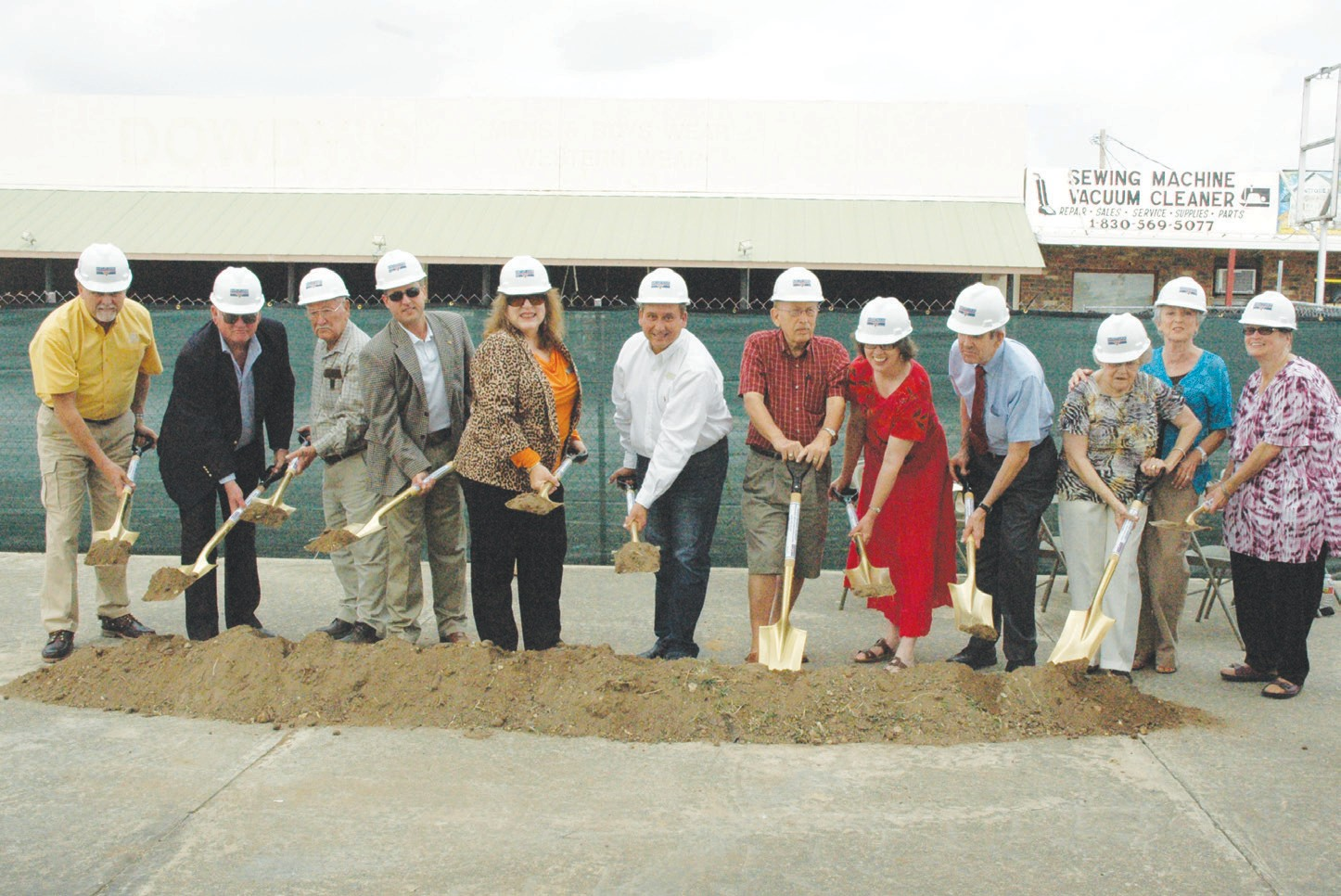 "Digging up some ceremonius dirt to launch the official start of the building of the Pleasanton Civic Center and Library are, from left, former mayors Bob Hurley and Bill Carroll, Council member Abraham Saenz, Mayor Clint Powell, Council members Jeanne Israel, J.R. Gallegos, Roger Garza, Kathy Coronado, Jimmy Magel and members of the Pleasanton Community Center group Dorothy Haverlah (also a former council member), Patsy Troell and Library Director Diana Guthrie. The buildings should be completed by February of 2014. Mayor Powell addressed the crowd that had gathered acknowleging that these public servants have been working a while to make this happen. ""Today we are here to celebrate the fact that we came together as a community – as a council and we're getting it done,"" said Powell."