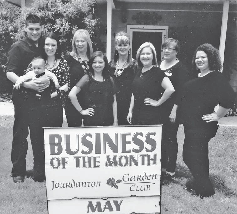 Standing in front of their salon in the front row, Jackie with baby Ethan, owner; Alyssa, hairdresser, Lauren, hairdresser, Mary, hairdresser; Back row: Johnny, owner, Doris, nailtech, Sarah, hairdresser and Becky, hairdresser.