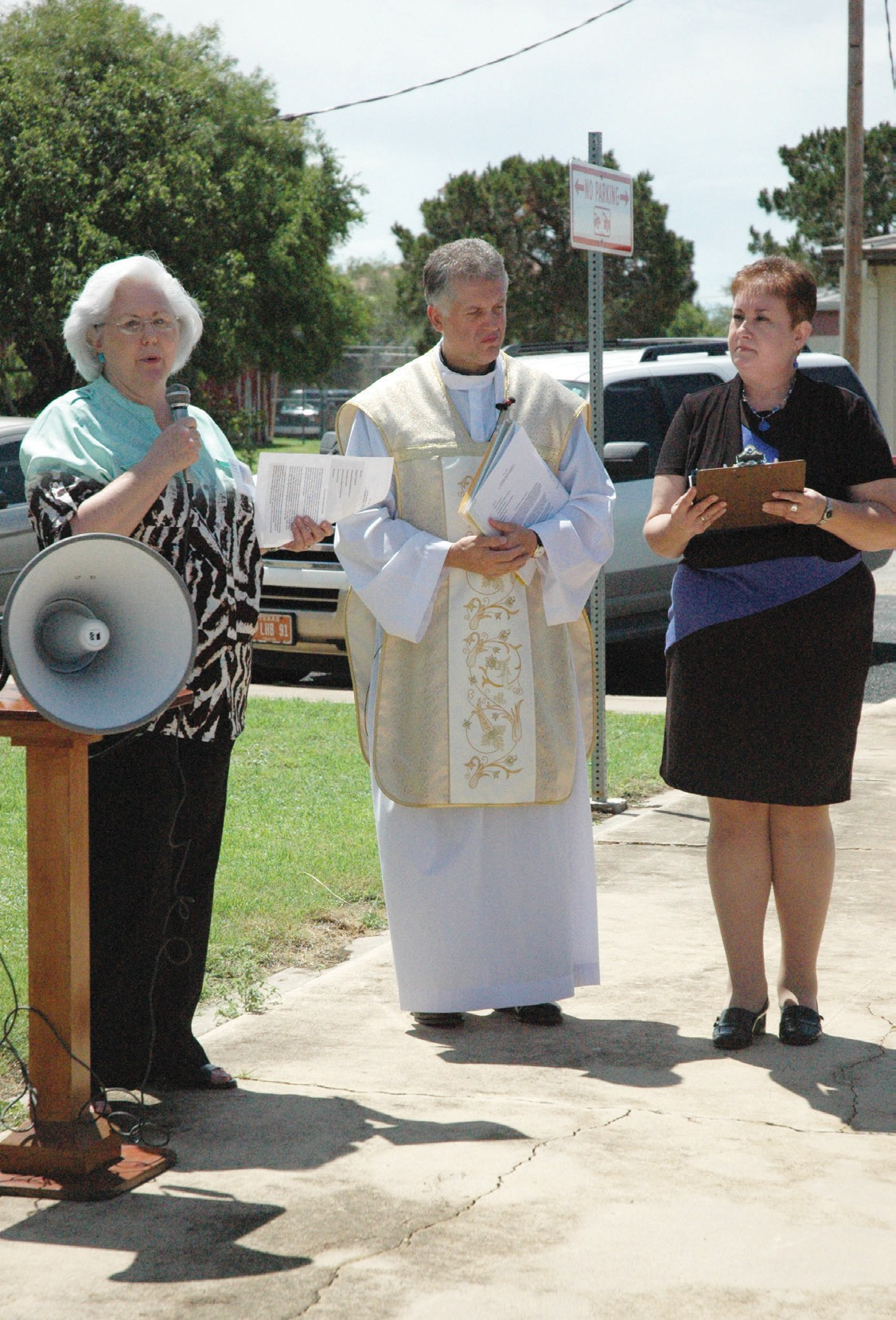 Barbara Westbrook of the Atascosa County Historical Commission addresses the crowd at St. Matthew's Catholic Church along with Father Kazimierz Oleksy and Debbie Netardus.