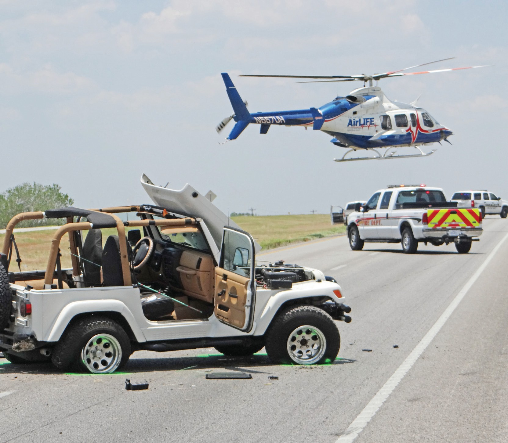 About 1:30 p.m. this Jeep was traveling southbound on I-37 when the driver lost control and ended up in the northbound lanes . A female passenger, thrown from the vehicle and was Airlifted from the scene. The accident caused traffic to be backed up for about a mile or more.