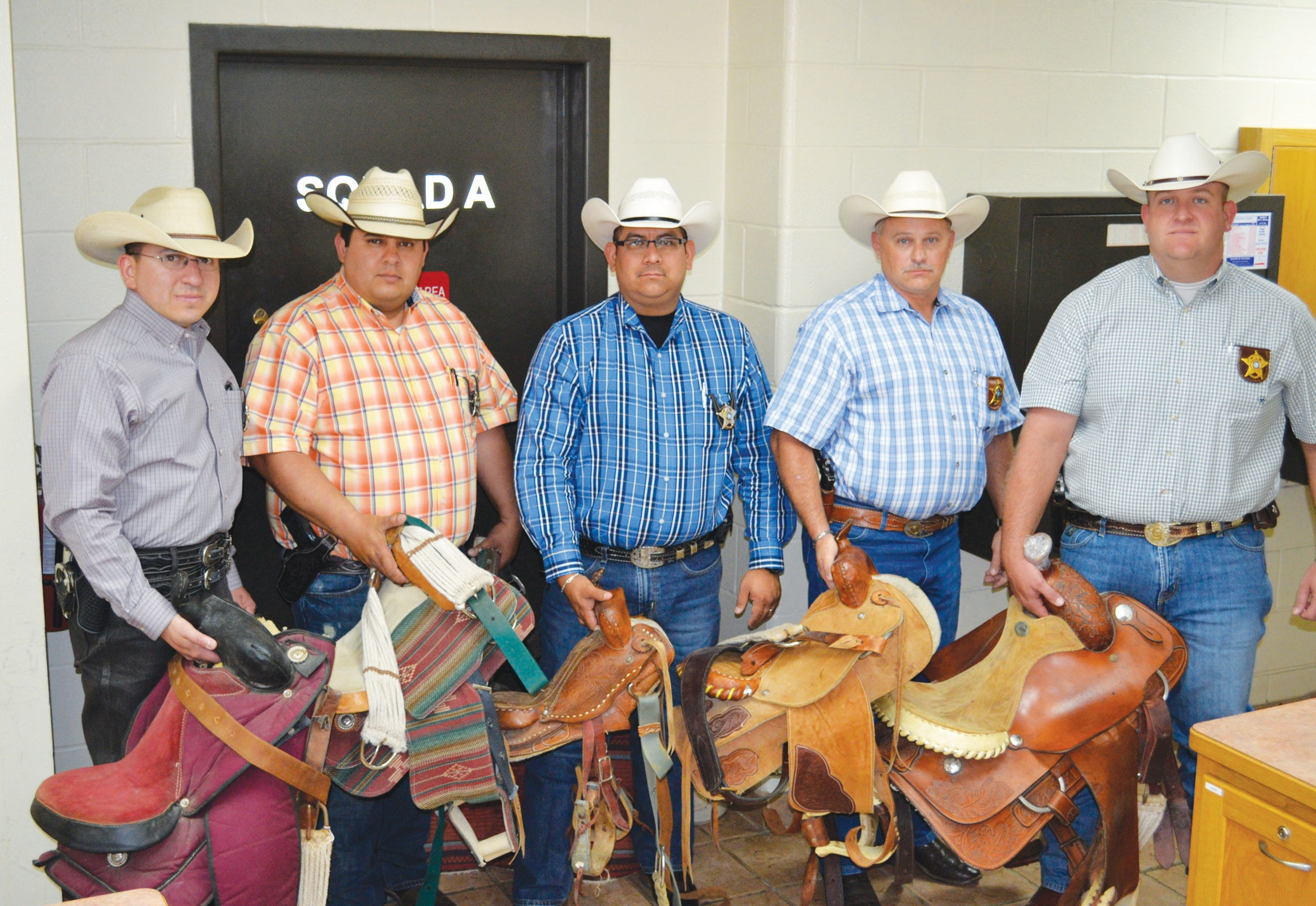 CID investigators pictured with the five recovered saddles stolen in a Verdi burglary are, from left, Sergeant Investigator Max Peralta, Sergeant Investigator Jesse Martinez, Sergeant Investigator Albert Garza, Lieutenant Inv. Wayne Stratton and Captain Investigator Matt Miller.