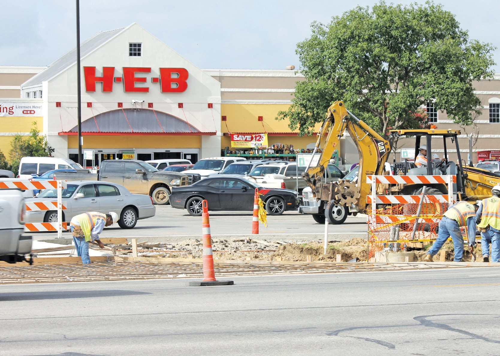 Recent foundation work on new entrance to Pleasanton H.E.B. Soon, a stop light will be erected at the entrance that is aligned with Reed Street.
