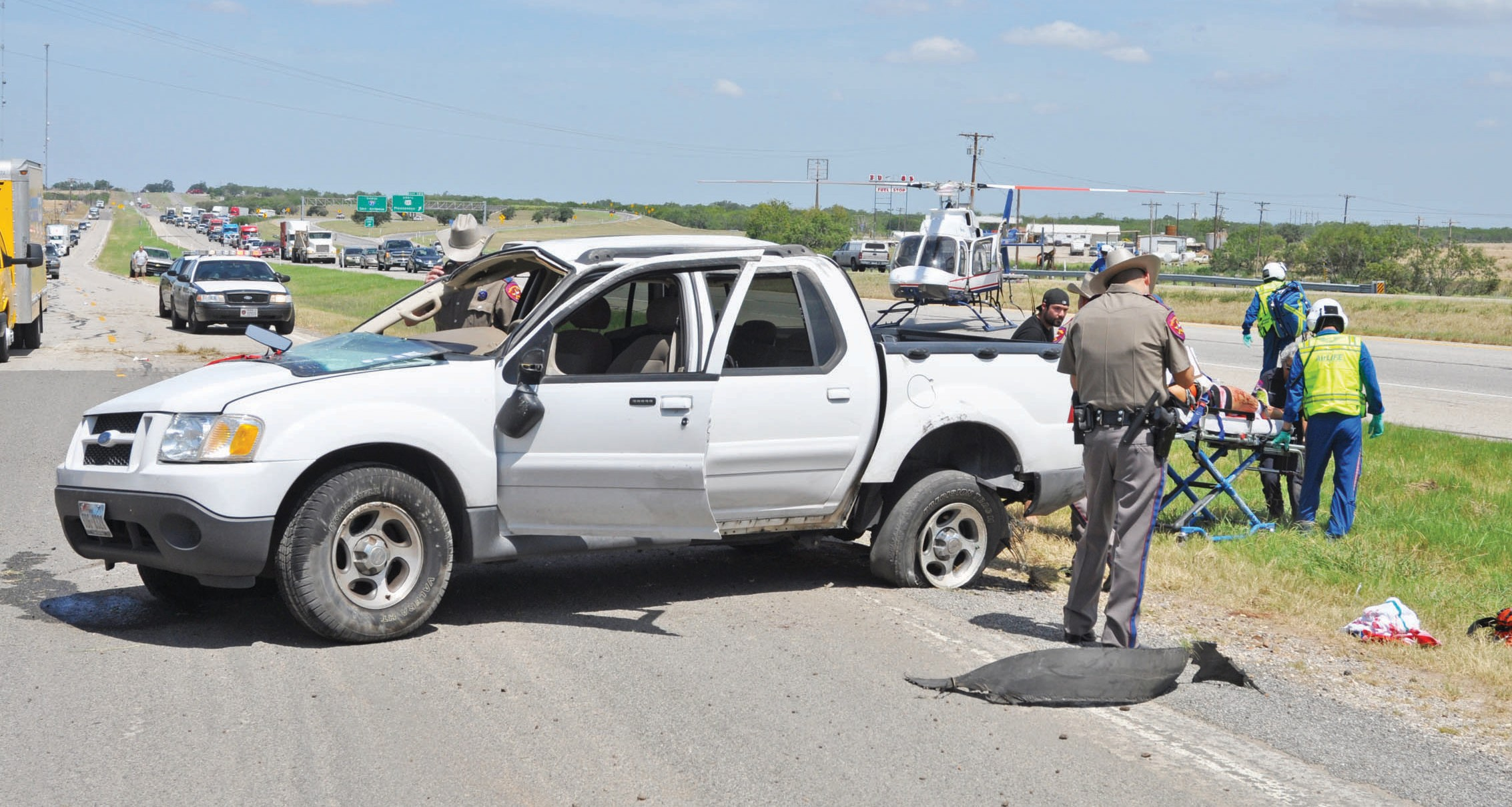 Around 11:00 am on Friday, August 2 this four door Ford pick up was going southbound on IH-37 when it rolled and landed near the access road. Airlife was dispatched for the female driver who suffered injuries to her arm and body.